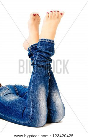 Female groomed legs in jeans isolated on white background