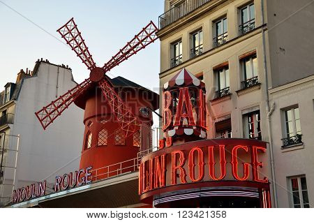 PARIS / FRANCE - September 24 2011: Moulin Rouge (Red Mill) the world famous cabaret in Paris one of the most popular tourist attraction in the city.