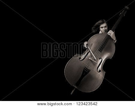 Contrabass musician over black background in sepia