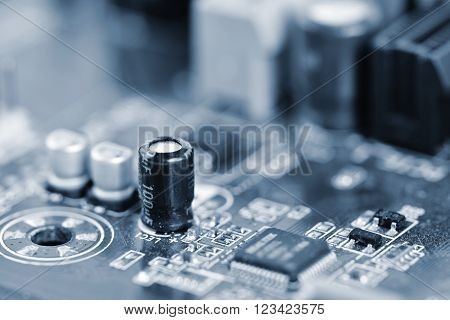 Components on board. PCB to PC. Chip, capacitor and connectors on the motherboard of a personal computer. Modern technological background. ** Note: Shallow depth of field