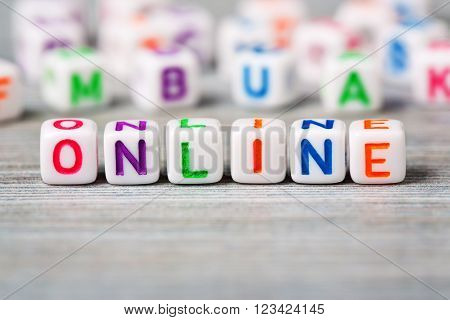 Macro of word Online on the wood background