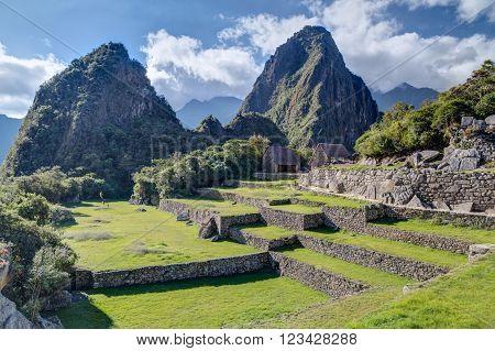 Terraces And Old Building Ruins In Machu Picchu,  Peru