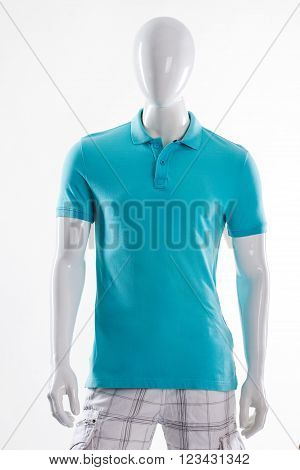 Blue polo t-shirt on mannequin. Male mannequin in fitted t-shirt. Man's t-shirt of bright color. Simple summer garment for men.