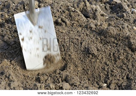 Moving garden spade topsoil preparation by seasonal digging.