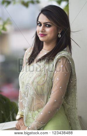 beautiful woman in light green saree indian attire smiling