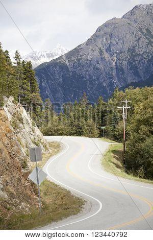 The winding road outside Skagway town (Alaska).