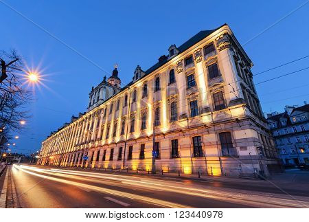Wroclaw university with vehicular light trails in the evening. Poland. Europe.