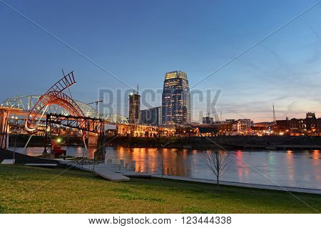 City of Nashville at dusk with river front