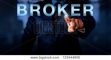 Manager is touching the word BROKER on a virtual touch screen interface. Business concept for the role of an independent agent trader facilitator negotiator mediating between a seller and a buyer. poster