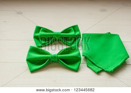 Green butterfly tie for groom on their wedding day