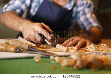 Artisan Lute Maker Chiseling Stringed Instrument Guitar ** Note: Shallow depth of field