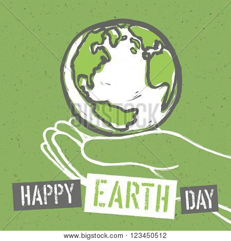 Happy Earth Day. Design for Earth Day. Concept Poster With Earth in hands. On recycled paper texture.