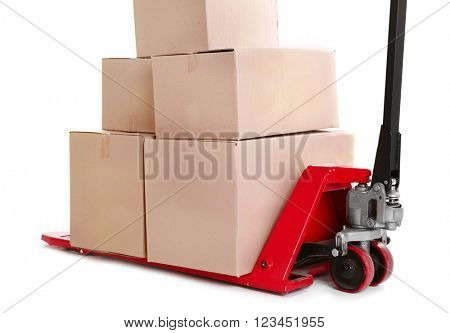 Fork pallet truck with stack of cardboard boxes isolated on white