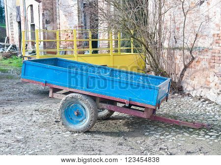 Old cart of blue ironi in a italian country