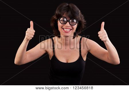 Portrait of a geeky young woman with double thumbs up