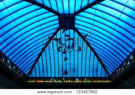 GDANSK POLAND - JULY 6 2009: Main post office on Langgasse with it's blue curved stained glass atrium simulating an aviary