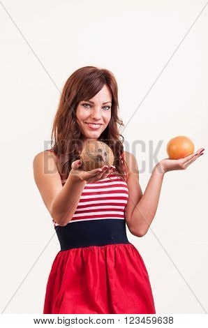 Beautiful Young Woman Offers A Coconut Instead Of Grapefruit