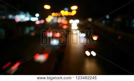 Night blur city road curved, abstract bokeh lights background