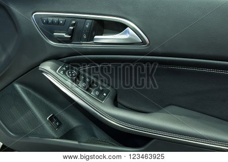 NONTHABURI - MARCH 23: Door Panel with Power window Controller of NEW Mercedes Benz CLA 200 Urban on display at The 37th Bangkok International Motor show on MARCH 23, 2016 in Nonthaburi, Thailand.