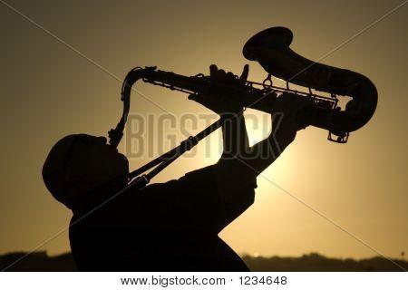Saxophonist At Dusk