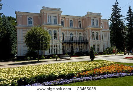KISLOVODSK,RUSSIA - AUGUST 06:The old building and flowerbed.Resort park - ornament and pride of Kislovodsk, Caucasus, Russia on August 06,2013.