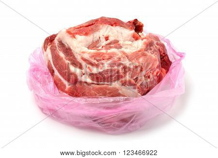Raw Pork meat in plasic bag isolated on white