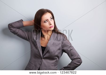 Annoyed Concentration Business Woman In Suit Looking Up On Blue Background