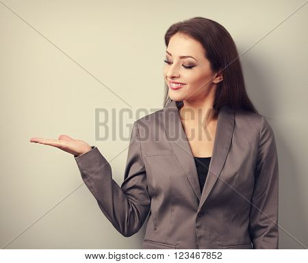 Happy Business Woman Holding Something Empty In Hand And Demonstration