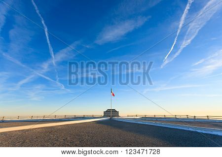 Italian flag on blue sky from first world war memorial in