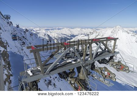 Cable car masts on a steep slope. Austrian Alps. The top of the Hintertux Glacier 3250 meters above sea level.