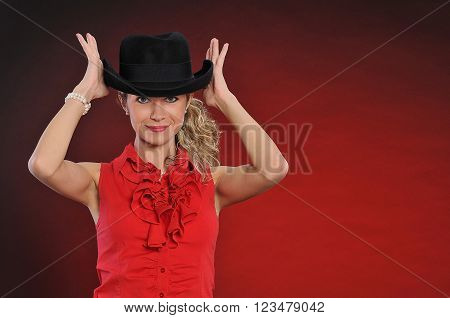 Fashion, girl in black  hat.  Lady in red