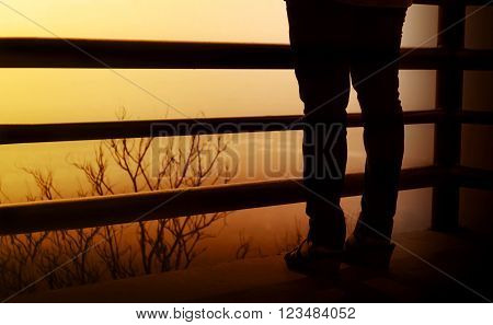 Backside Of Women Leg On Balcony And Highland View Blurred Background