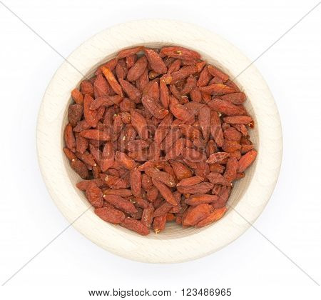 Dried Goji berries in wooden bowl on white isolated background