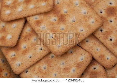 Dry sguare crackers on a wooden table
