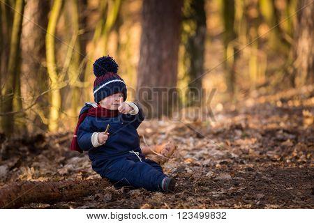 Caucasian Boy Playing Outdoor At Springtime