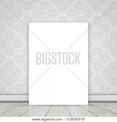 Blank canvas on the floor leaning against a wall with Damask wallpaper pattern