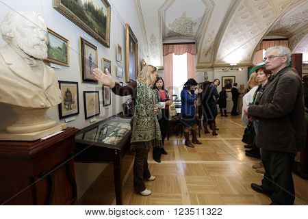 ST. PETERSBURG, RUSSIA - MARCH 24, 2016: Chief curator of the Literary Museum Ksenia Chudakova holds the presentation for tour operators and media representatives