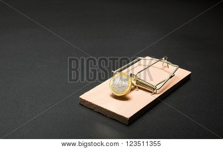 Gold coin in mouse trap