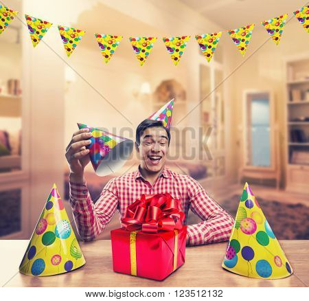 Man playing with Birthday hats