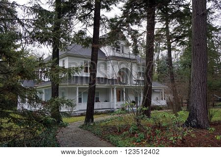 HARBOR SPRINGS, MICHIGAN / UNITED STATES - DECEMBER 23, 2015: A large white mansion in the private Glenn Woods Association in Harbor Springs, Michigan.