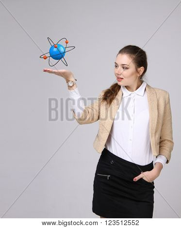 Woman scientist with atom model, research concept