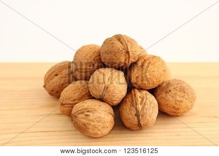English or Persian walnuts on a wooden background. ** Note: Soft Focus at 100%, best at smaller sizes