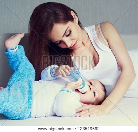 young mother and her one year old baby at home