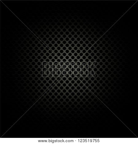 Dark perforated metal background with highlight in middle