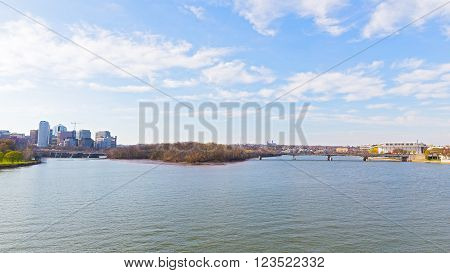 Panoramic view over Potomac river in Washington DC. Rosslyn skyline, the Key Bridge and Kennedy Center for the Performing Arts in spring.