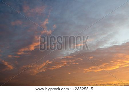 Sunset sky covered by colorful stratocumulus clouds