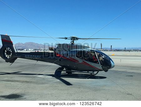 LAS VEGAS, NEVADA - MARCH 26, 2016: Maverick Airbus Helicopter EC130 takes off from Las Vegas Airport for Grand Canyon Tour