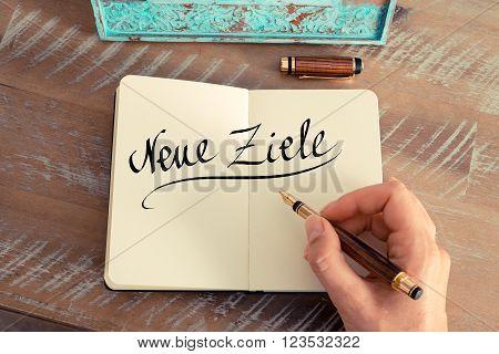 """Handwritten Text In German """"neue Ziele""""  - Translation : New Goals"""