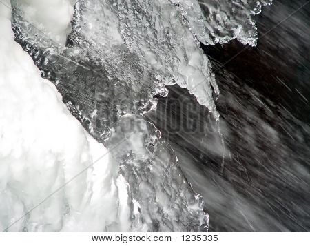 large section of snow and ice above flowing waterfall poster