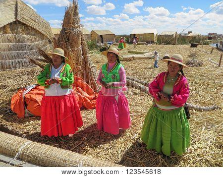 Puno, Peru - Circa June 2015: Women Singing At Uros Floating Island And Village On Lake Titicaca Nea